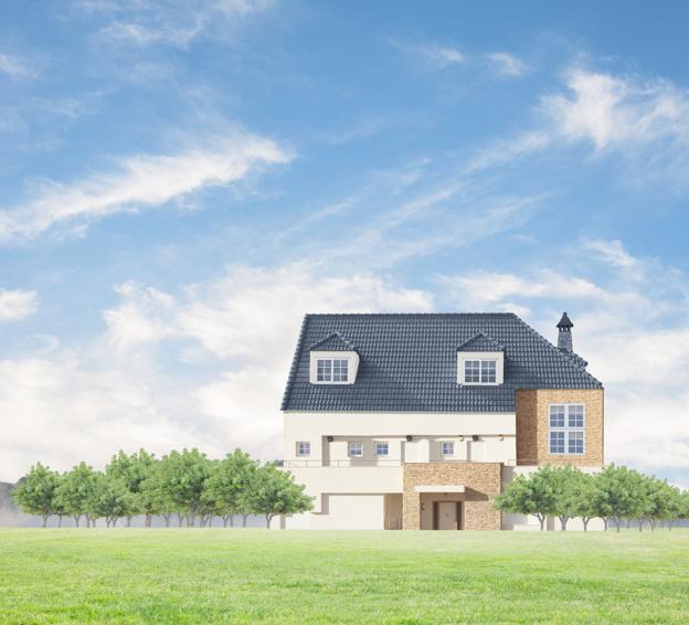 Dom z czarnym dachem na tle nieba